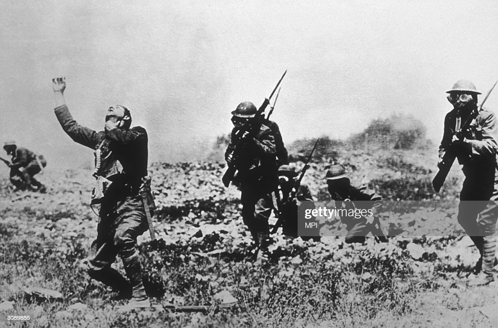 A soldier without a mask succumbs to the fumes in a posed gas attack in France during WWI.
