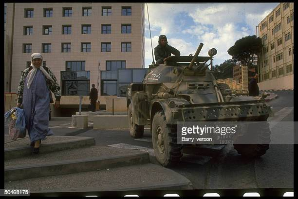 Soldiermanned Army APCs on patrol in wake of fundamentalist FIS election victorysparked mil ouster of Chadli govt cancelling 2nd elections round
