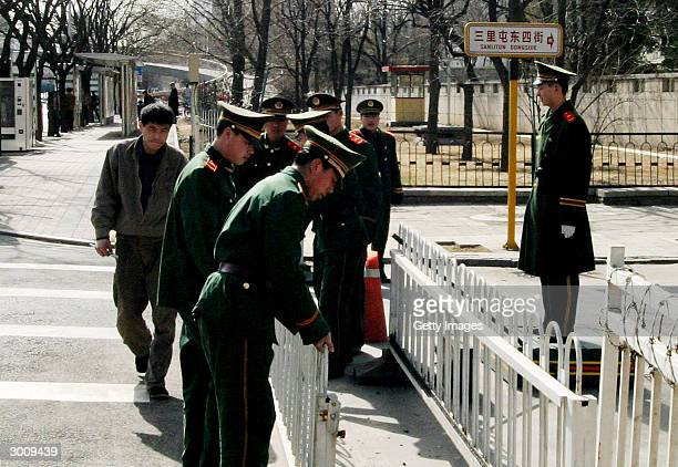 Soldiers add additional fences to the highly sealedoff diplomatic district after several suspected asylum seekers were transfered there February 24...