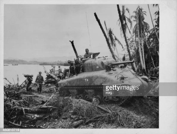 US soldiers advancing across the South Pacific to surround Japanese forces during World War Two Dutch New Guinea May 13th 1944
