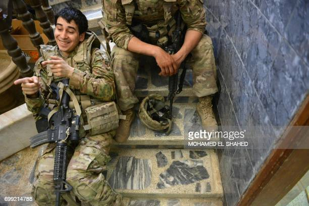 US soldiers advising Iraqi forces are seen in the city of Mosul on June 21 during the ongoing offensive by Iraqi troops to retake the last district...