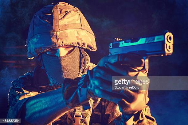soldiers aiming with his pistol.