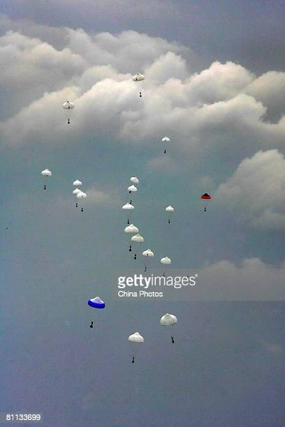 Soldiers airdrop emergency relief goods to be sent to earthquakedamaged Wenchuan County from the Taipingsi Airport on May 17 2008 in Chengdu of...