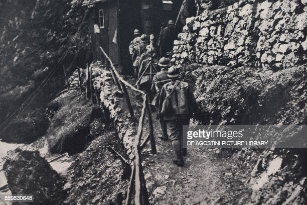 Soldiers along a path on Mount Corno Italy World War I from l'Illustrazione Italiana Year XLV No 21 May 26 1918