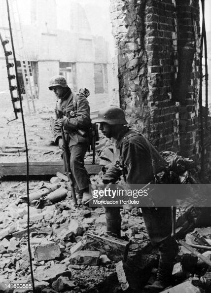 Soldiers among the ruins of the 'Red barricade' factory in Stalingrad today Volgograd waiting to continue the action Stalingrad October 1942
