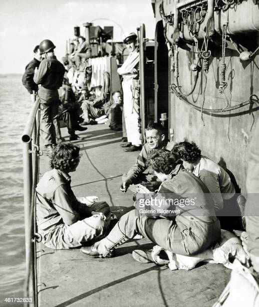 Soldiers and ANC's are sitting on a Landing Craft of the Army Nurse Corps June 1944 The LCI has been in Utah June 6 1944 and will soon return to US...