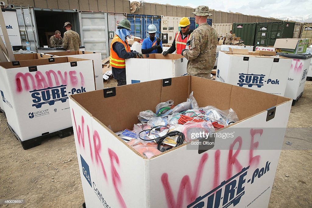 Soldiers and civilian contractors sort through shipping containers filled with excess equipment and supplies left by departing units as the U.S. draws down manpower in the 13-year-old war on March 22, 2014 near Gardez, Afghanistan. Although some of the material will be put back into the Army supply chain most of it will be destroyed or sold for scrap. In the past year the U.S. Military has been reducing troops and equipment in Afghanistan as it transitions from a role of combatants, fighting alongside Afghan soldiers, to assisting the Afghan National Security Forces in an advisory role. President Obama recently ordered the Pentagon to develop a contingency plan for a complete pullout from Afghanistan by the end of 2014 if Afghanistan President Hamid Karzai or his successor refuses to sign the Bilateral Security Agreement.