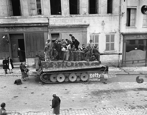 Soldiers and civilians examine a captured German 'tiger' tank Marle France September 20 1944 | Location Marle France