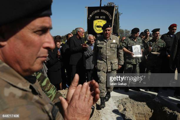 Soldiers and mourners attend the funeral of Georgiou Theodoulos Theodoulou on March 5 2017 in Pera Chorio Nisou Cyprus Theodoulou was an 18yearold...