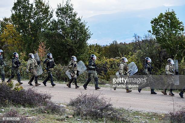 US soldiers and NATO ledpeacekeeping mission in Kosovo take part in a field exercise in the village of Nashec near the town of Prizren on October 27...