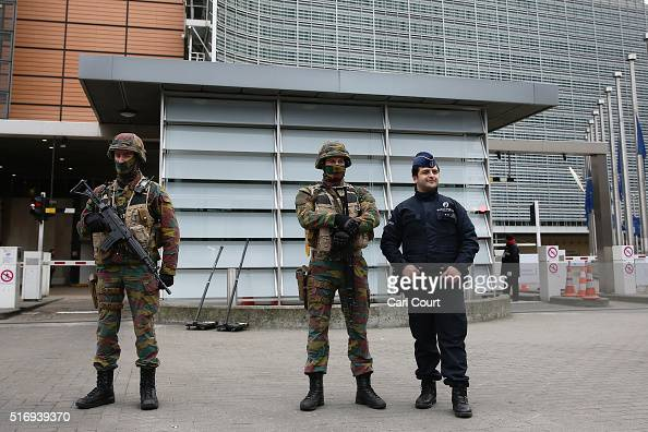 Soldiers and police officers stand guard outside EU Commission Headquarters following todays attack on March 22 2016 in Brussels Belgium At least 31...