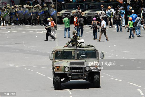 Soldiers and police take position around Victory Monument after they cleared a roadblock set by antigovernment 'Red shirts' militants from the United...
