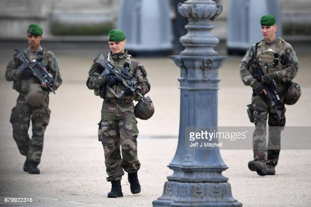 Soldiers and security patrol The Louvre where Emmanuel Macron will celebrate later should he win the French election on May 7 2017 in Paris France...