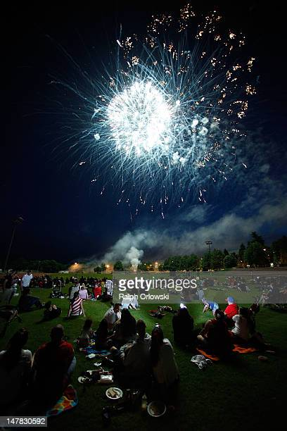 S soldiers and their families watch fireworks during the Fourth of July festivities at the Baumholder US military base on July 4 2012 in Baumholder...