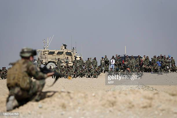 Soldiers and trainees from the Afghan National Army observe training exercises and manoeuvres operated by French Army's mentors members of the...