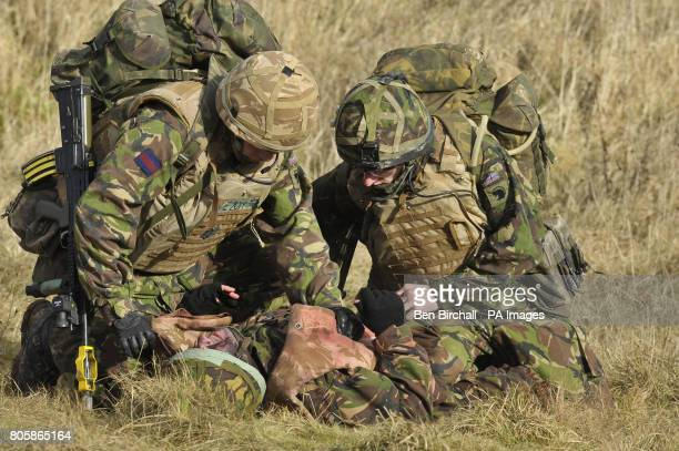 Soldiers apply field first aid to a simulated casualty in preperation for the Medical Emergency Response Team to arrive in a Chinnook helicopter as...