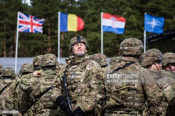 CORRECTION US soldiers are pictured prior the beginning of the official welcoming ceremony of NATO troops in Orzysz Poland on April 13 2017 The...