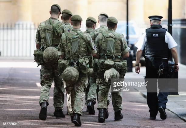 Soldiers are seen arriving near Buckingham Palace on May 24 2017 in London England 984 military personnel are being deployed around the country as...