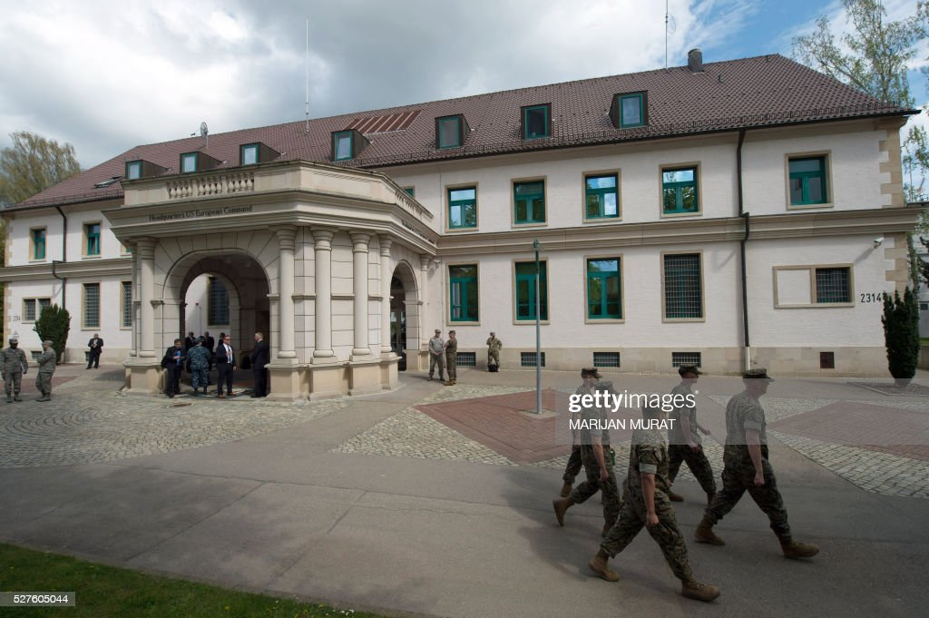 US soldiers are seen in front of the United States European Command (EUCOM) on May 3, 2016 at the Patch Barracks in Stuttgart, southern Germany. A ceremony took place at the barracks as US General Curtis Scaparrotti was introduced as Commander of the US European Command, taking over from US General Philip Breedlove. / AFP / dpa / Marijan Murat / Germany OUT