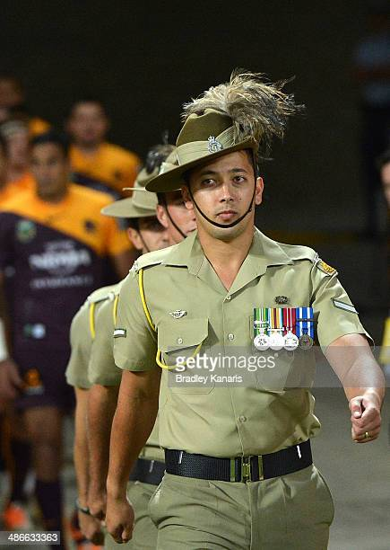 Soldiers are seen leading the Broncos team out to the field of player before the round 8 NRL match between the Brisbane Broncos and the South Sydney...