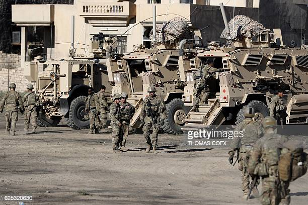 US soldiers are seen next to their armoured vehicles near an Iraqi army base on the outskirts of Mosul on November 23 2016 Forces battling the...