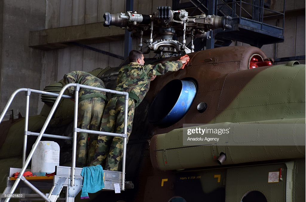 Soldiers are seen on a helicopters during the ceremony of 2 transport helicopter which Serbia bought from Russia, at Nikola Tesla Airport in Belgrade, Serbia on June 28, 2016.