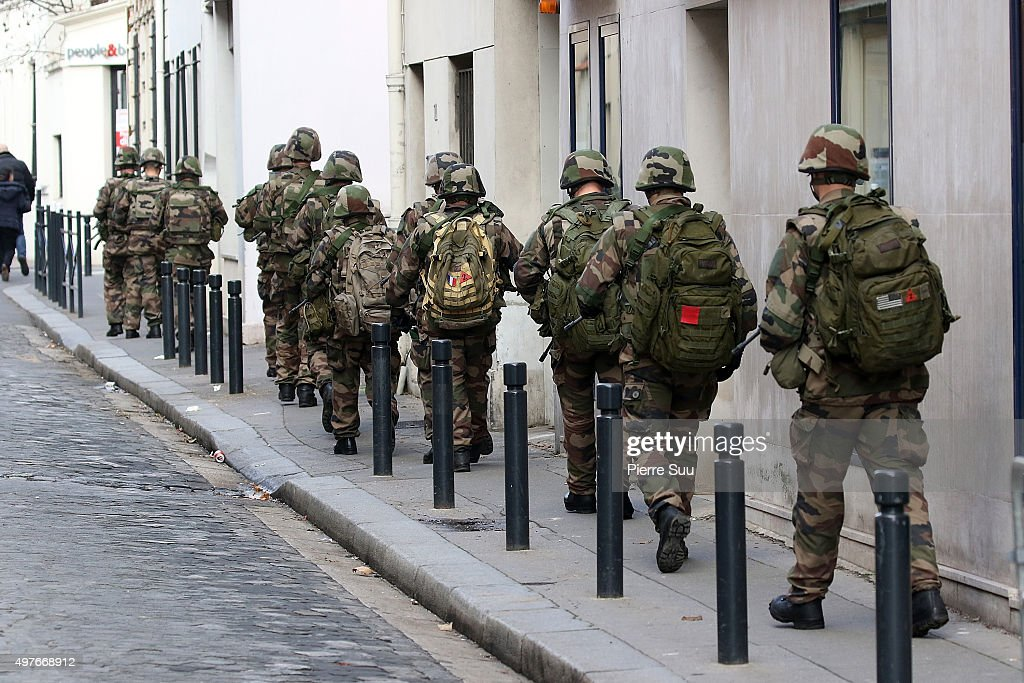 Soldiers are seen patrolling a street of Saint Denis during an antiterrorist raid on November 18 2015 in SaintDenis France French Police special...