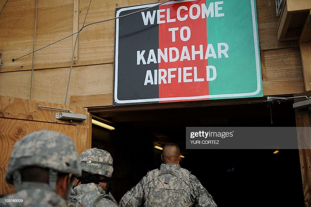 US soldiers arrive at the Kandahar airfield after disembarking from an Australian C130 military airplane with other NATO soldiers in Kandahar on July...