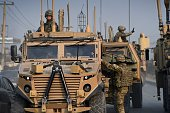 US soldiers arrive at the scene following a suicide car bomb attack on a European Union police vehicle along the KabulJalalabad road in Kabul on...