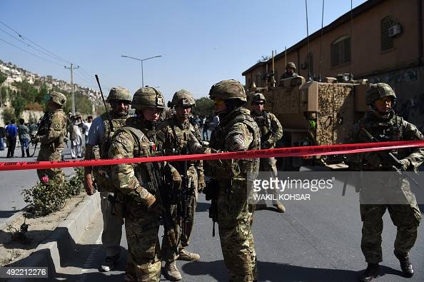 NATO soldiers arrive at the scene of a suicide car bomb attack that targeted foreign military vehicles at JoeSher in Kabul on October 11 2015 A...