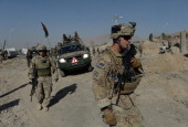 US soldiers arrive at the site of a suicide attack in Maidan Shar the capital city of Wardak province south of Kabul on September 8 2013 At least...