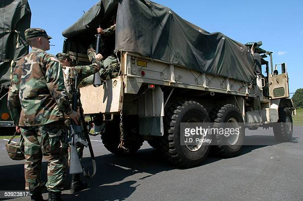 Soldiers assigned to Company B 1148th Infantry Battalion of the Ohio National Guard load into a truck before being deployed to the stormravaged Gulf...