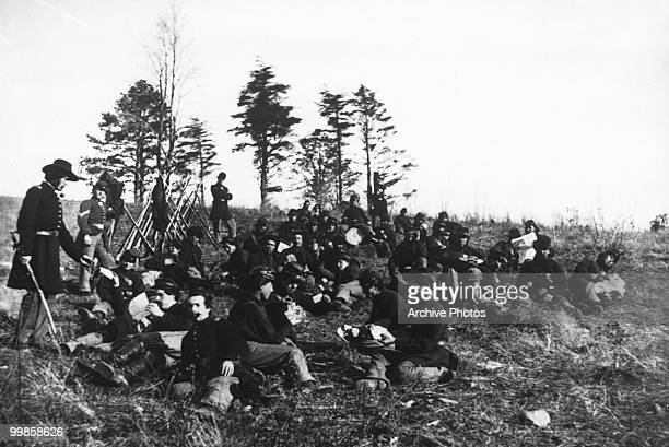 Soldiers at rest after drill in Petersburg Virginia during the US civil war circa 1864
