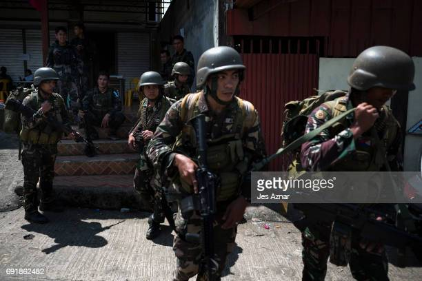 Soldiers being deployed to the frontine insdie the city being sieged by militants are transported to safer grounds on June 3 2017 in Marawi City...