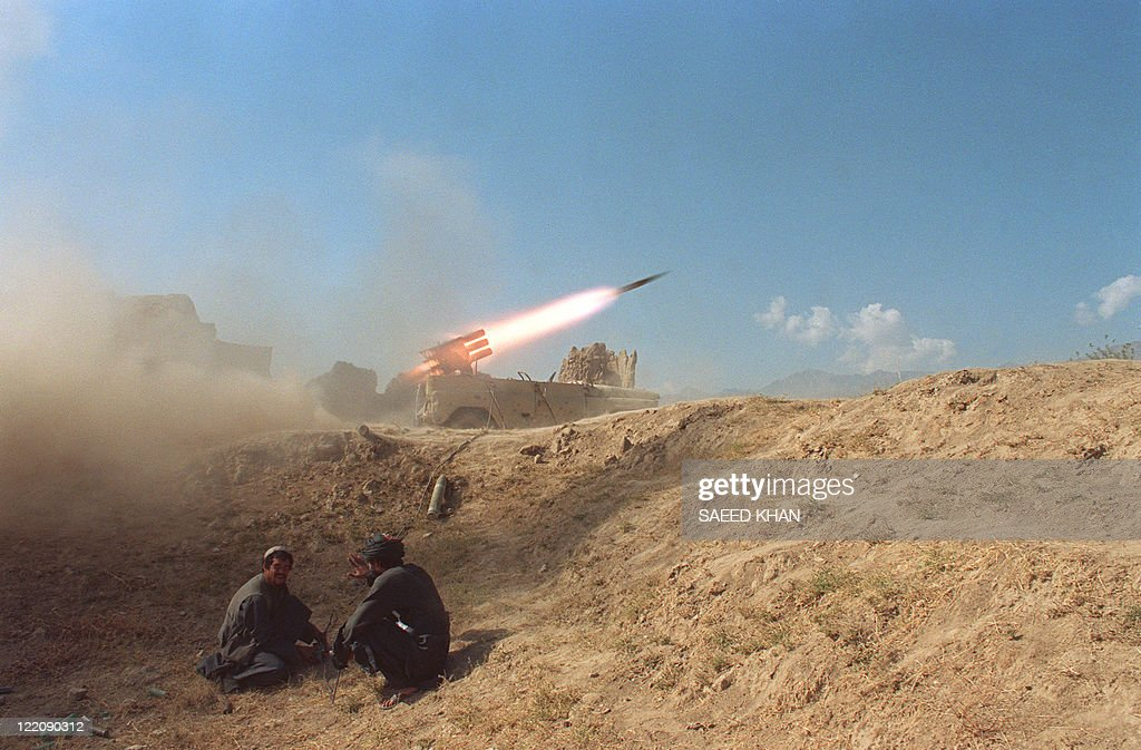 Soldiers belonging to strict Moslem Taliban militia fire a 12barrel rocket launcher in Qala Murad Beg front line 12 October 1996 20 kms north of...