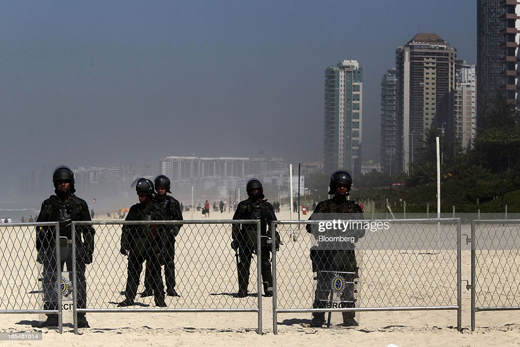 Soldiers block the beach entrance to the Windsor Barra Hotel in Rio de Janeiro, Brazil, on Monday, Oct. 21, 2013. Soldiers, army vehicles, helicopters and navy ships are guarding a Rio de Janeiro hotel where companies including China National Petroleum Corp., Royal Dutch Shell Plc and Total SA are expected to vie for one of the worlds two largest offshore fields at 3 p.m. local time, as oil workers protest the concession. Photographer: Dado Galdieri/Bloomberg via Getty Images