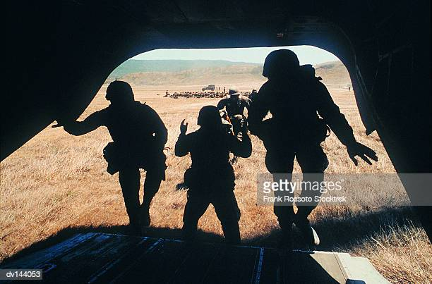 Soldiers boarding CH-47 Chinook Helicopter in training exercise