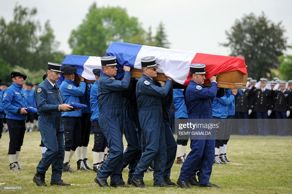 Soldiers carry a coffin during the funeral of four mountain rescue specialist police officers, killed after a helicopter crash in the Cauteret region of the Pyrenees mountains, on May 26, 2016 in Tarbes. Four French police were killed May 20 when their helicopter crashed in the Pyrenees, in one of the deadliest such incidents in recent years. The dead, who were all in their 40s, included the pilot, co-pilot and two mountain rescue specialists involved in a training exercise, local authorities said. GABALDA