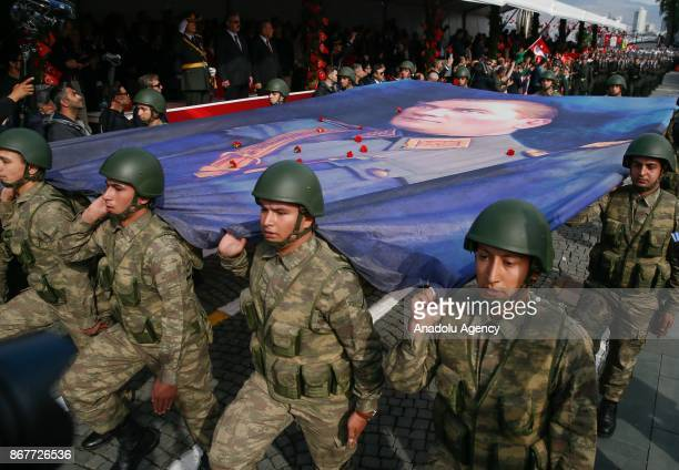 Soldiers carry the Ataturk's flag as they march during the celebrations for the 94th Anniversary of Republic Day at the Izmir Cumhuriyet Square in...
