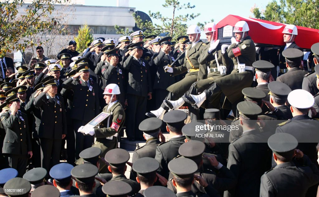 Soldiers carry the coffin of army officer Yakup Cinar, one of 17 Turkish soldiers who were killed in a helicopter crash early on November 9, 2012 in Siirt province, during his funeral in Ankara on November 12, 2012. The Turkish military helicopter crashed on November 9, 2012 in bad weather in the southeastern city of Siirt, killing all 17 troops on board, local officials said.