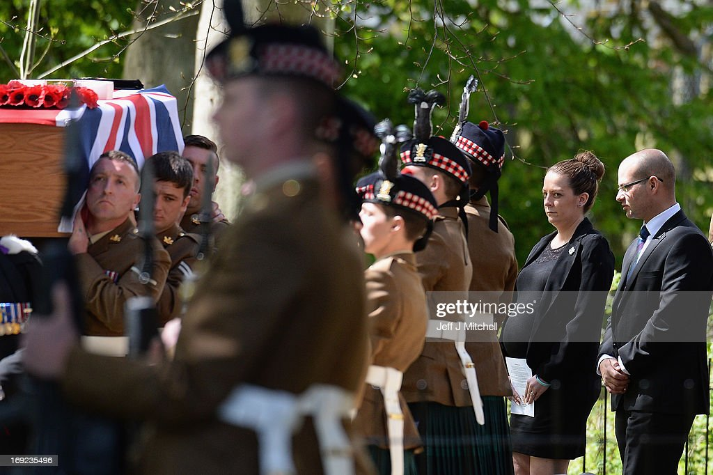 Soldiers carry the coffin of Corporal William Savage from The Royal Highland Fusiliers, 2nd Battalion The Royal Regiment Of Scotland, followed by his wife Lyndsey, who is pregnant with their first child, during the funeral at Glencorse Kirk on May 22, 2013 in Penicuik, Scotland. Corporal Savage was killed along with Fusilier Samuel Flint and Pte Robert Hetherington when their Mastiff vehicle was hit by an improvised explosive device while on patrol in Helmand province in Afghanistan on April 30.