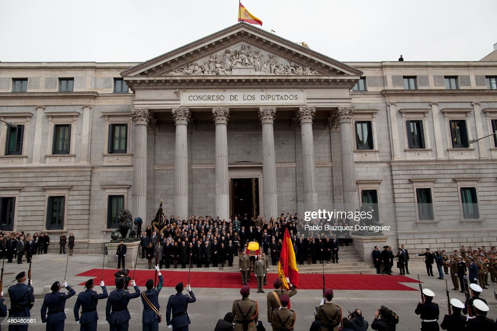 Soldiers carry the coffin of former Spanish prime minister Adolfo Suarez from the funeral chapel in the Spanish parliament as it makes its way to Avila, Spain for the burial on March 25, 2014 in Madrid, Spain. Suarez, who died on March 23 in Madrid, was the first democratically elected Spanish prime minister after the death of dictator General Francisco Franco.