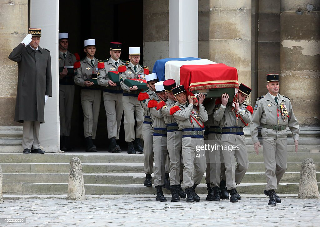 Soldiers carry the coffin of late French Staff Sergeant Harold Vormezeele during a national tribute ceremony held in the Hotel des Invalides courtyard on February 22, 2013 in Paris. Vormezeele, a NCO and commando with the 2nd Foreign Parachute Regiment, an elite unit of the French Foreign Legion, was killed on February 19 during an operation in northern Mali against Islamist rebels. He was the second French soldier killed since the start of France's military intervention in Mali on January 11.