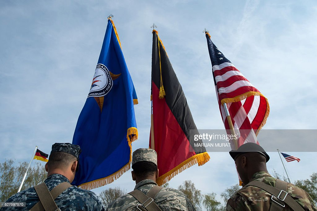 US soldiers carry the flags of (L-R) the United States European Command (EUCOM), Germany and the US during a ceremony on May 3, 2016 at the Patch Barracks in Stuttgart, southern Germany. The ceremony took place as US General Curtis Scaparrotti was introduced as Commander of the US European Command, taking over from US General Philip Breedlove. / AFP / dpa / Marijan Murat / Germany OUT