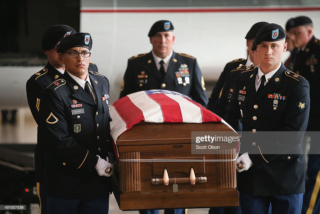 Soldiers carry the remains of Army Pfc. Aaron Toppen from a charter aircraft to a hearse at Midway Airport on June 21, 2014 in Chicago, Illinois. Toppen, 19, was killed alongside four other American Soldiers and an Afghan soldier in a friendly fire airstrike during a firefight earlier this month in Afghanistan.