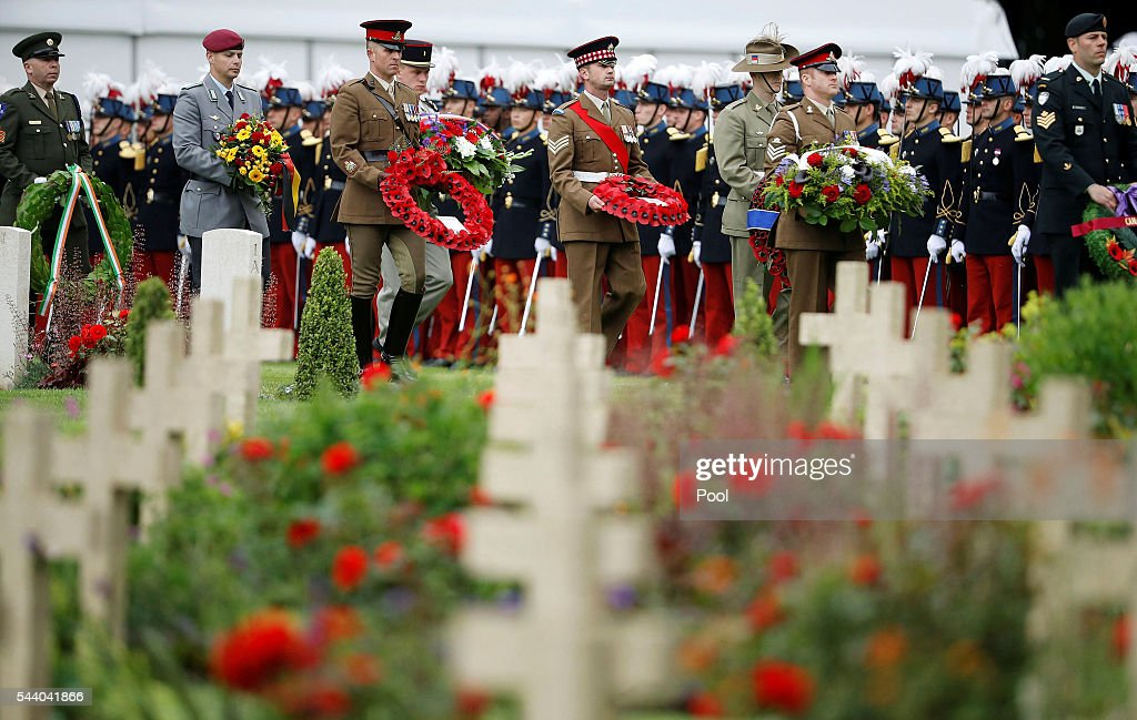 Soldiers carry wreaths as they during the 100th anniversary of the beginning of the Battle of the Somme at the Thiepval memorial to the Missing on July 1, 2016 in Thiepval, France. The event is part of the Commemoration of the Centenary of the Battle of the Somme at the Commonwealth War Graves Commission Thiepval Memorial in Thiepval, France, where 70,000 British and Commonwealth soldiers with no known grave are commemorated.