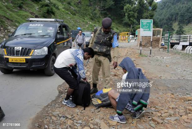 Soldiers check bags near temporary barricade on July 11 2017 in Pahalgam around 100 kilometers south of Srinagar India Seven pilgrims on the Amarnath...
