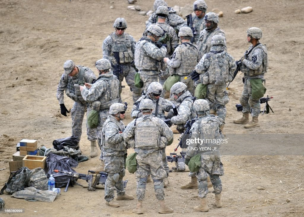 US soldiers check their equipments at a military training field in the border city of Yeoncheon, northeast of Seoul, on April 11, 2013. The United States has warned North Korea it is skating a 'dangerous line' with an expected missile launch that could start a whole new cycle of escalating tensions in a region already on a hair-trigger.