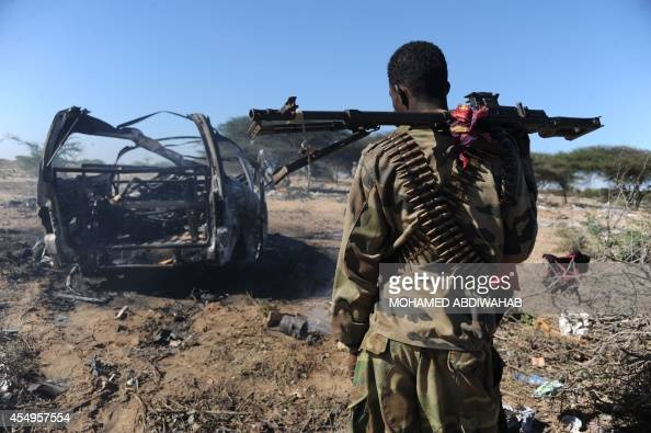 A soldiers checks the area where a suicide bomber from Somalia's Shebab insurgents killed at least 12 people and wounded 27 others on September 8 by...