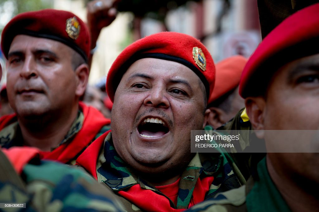 Soldiers cheer during a ceremony to commemorate the 24th anniversary of former Venezuelan President Hugo Chavez's military coup against the...
